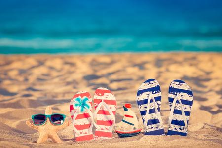 Beach flip-flops on the sand. Summer vacation concept