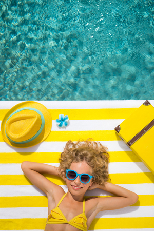Top view portrait of child near the swimming pool. Summer vacation concept