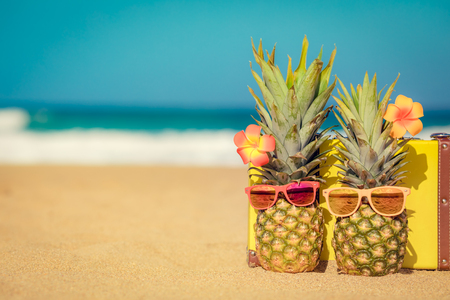 Pineapple on the beach. Summer vacation and travel concept
