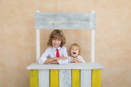 Happy children pretend to be businessmen. Funny kids playing at home. Education, start up and business idea concept Reklamní fotografie