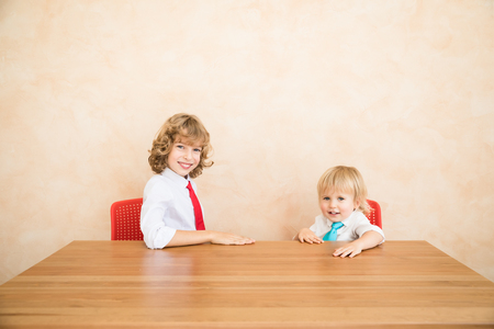 Happy children pretend to be businessmen. Funny kids playing at home. Education, start up and business idea concept Stock Photo