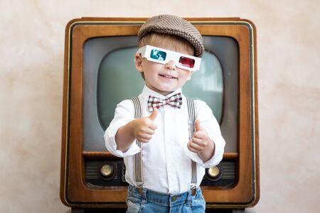 Funny kid wearing 3d glasses. Happy child having fun at home. Retro cinema concept