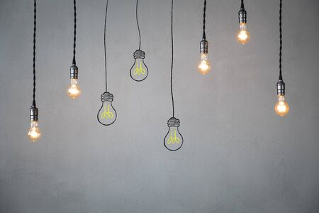 Many light bulbs against concrete wall background. Idea concept
