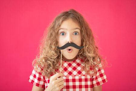 Funy girl with fake mustache against pink background