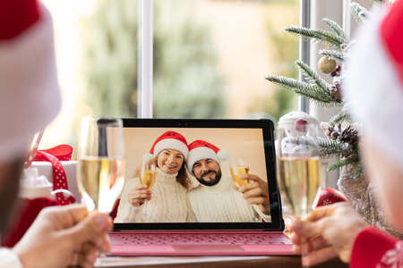 Family celebrating Christmas holiday online by video chat in quarantine. Lockdown stay home concept. Xmas party during pandemic Foto de archivo