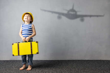 Happy child dreaming about travel. Summer vacation concept