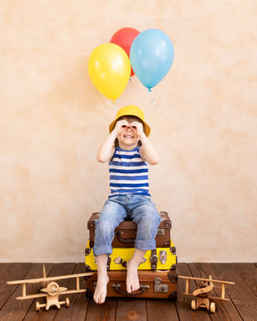 Child pretend to be traveller. Kid having fun at home. Summer vacation and travel concept