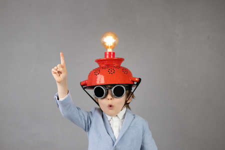 Smart child pretend to be businessmen.