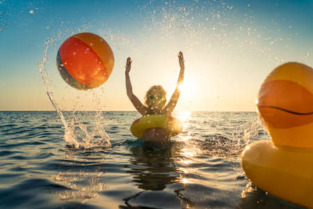 Happy child having fun on summer vacation.