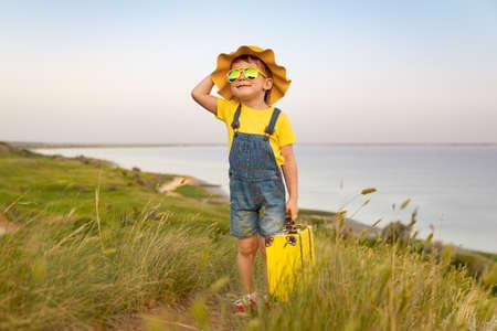 Happy child against blue sea 스톡 콘텐츠
