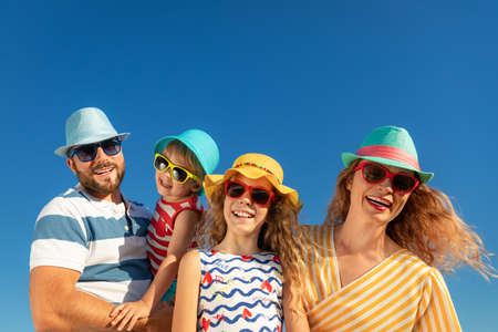 Mother, father, daughter and son on summer vacation