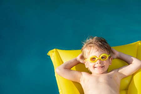 Happy child swimming in pool. 스톡 콘텐츠