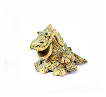 ceramic figurine of smiling yellow and green dragon - the symbol of 2012 year photo