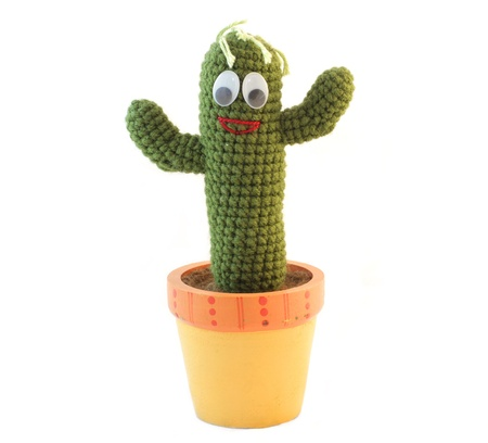 Happy Smiling Cactus Knitting in the flowerpot on white background photo