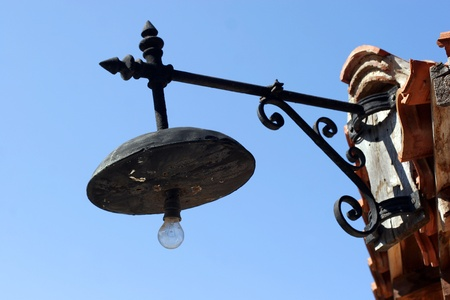 old forged lantern in Old Nessebar on blue sky photo