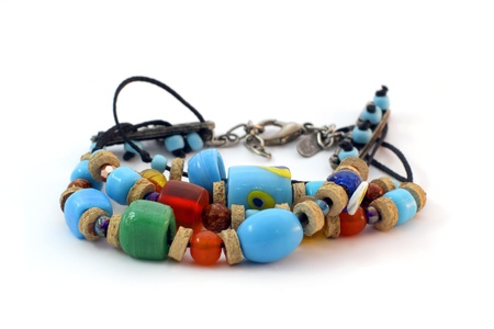 love proof: colorful handmade indian bracelet on white background