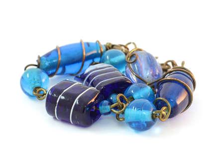 Bracelet handmade from Murano glass on a white background photo