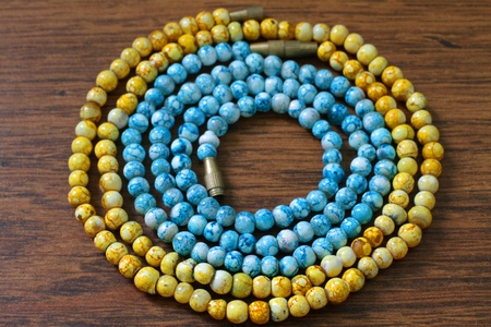 yellow and blue plastic beads on brown background Stock Photo - 12940107