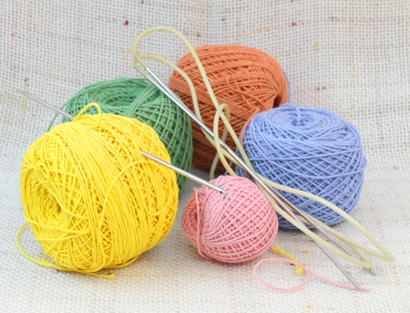 Knitting coloured balls and knitting needles and hook photo