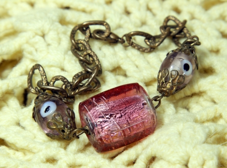 Bracelet handmade from Murano glass on the knitted scarf photo