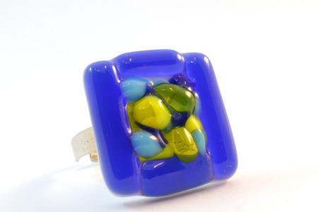 origina blue glass handmade ring on white background photo