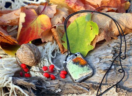 amulet: Ethnic handmade clay amulet on autumn-style background Stock Photo