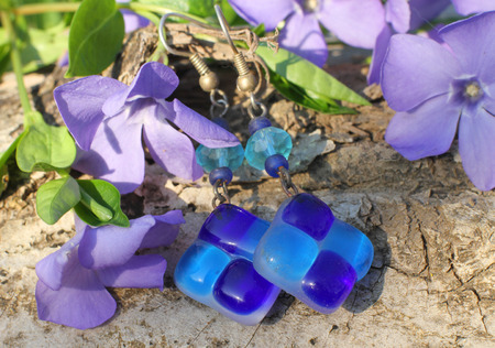 frippery: Handmade glass and bead earrings with wood violet in spring on the nature background