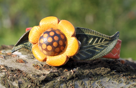 A leather bracelet with a flower eco style hand made