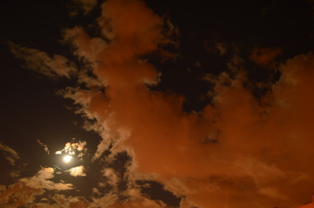 aureole: Big white cloud approaching full moon glowing circle of the full moon Stock Photo