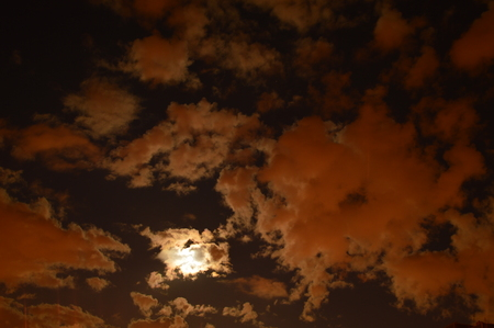 aureole: Evening sky light of the moon at the full moon through the cloud Stock Photo