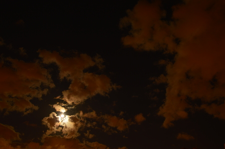 evening glow: The moon in the sky full moon between clouds evening glow