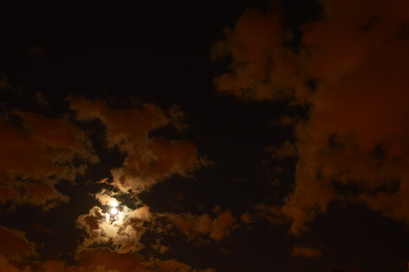 aureole: The sky over the city in a full moon at the end of summer Stock Photo