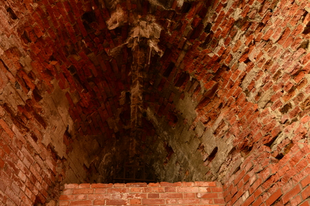 loopholes: loopholes in the ancient fortress of brick red brick Stock Photo