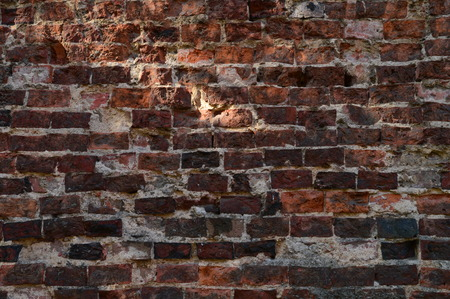 fondo rojo: pared de ladrillo antigua fortaleza Foto de archivo