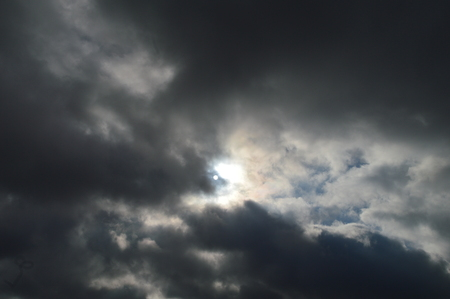 spaciousness: The sun in the haze of dark autumn clouds