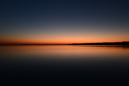 Twilight sky above the water surface of the lake Stok Fotoğraf