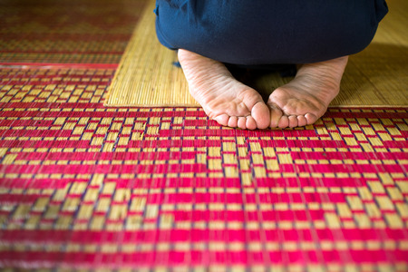 Meditation in the temple, feet on the rug for meditations