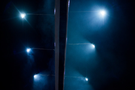 searchlights: Searchlights at night on an advertising billboard Stock Photo