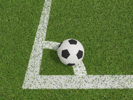 voetbal of voetbal in het groene gras veld op conner