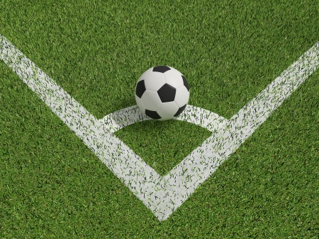 premier: football or soccer in green grass field on conner  Stock Photo