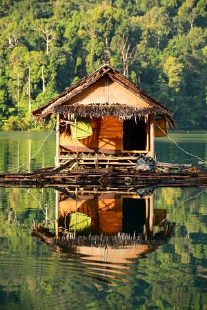 floating home, Cheow Lan lake, Khao Sok National Park, Thailand photo