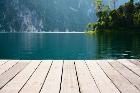 wood terrace on the lake,Cheow Lan lake, Khao Sok National Park, Thailand photo