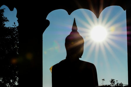 loei: silhouette sunset of buddha on Phu Rua ,Thailand   Stock Photo