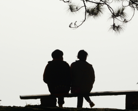 love couple: silhouette couple love sitting  on  bench Stock Photo