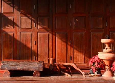 Thai style vintage wooden door with terrace  in Chaingkhan, Thailand  photo