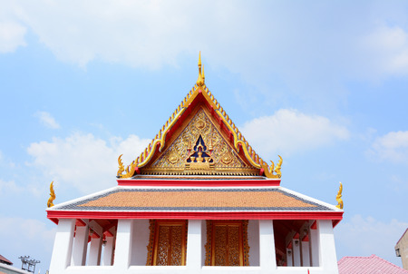 Gable roof on Thai temple  wiht blue sky in  Bangkok, Thailand photo