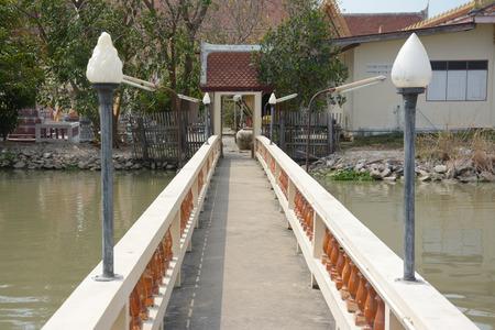 samutprakarn: concrete bridge cross a pond to the temple ,Samutprakarn in Thailand