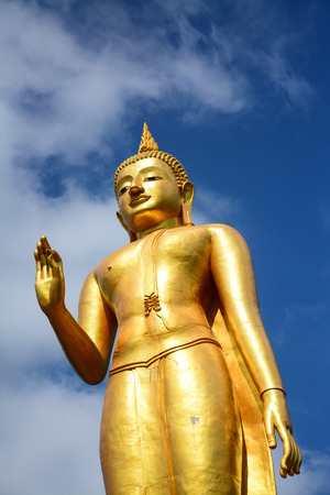 statue buddha on blue sky background in songkhla,Thailand photo