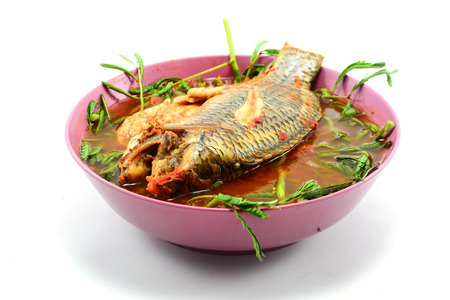 Sour soup made of tamarind paste with fish  photo