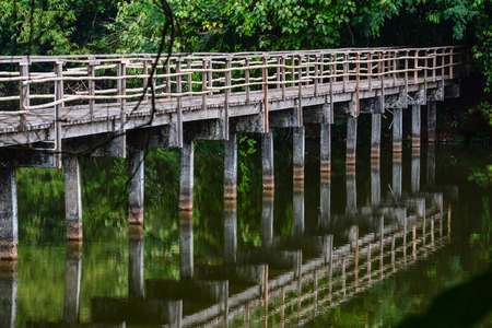 namtok: wood bridge in  Krating Waterfall National Park at Chantaburi, Thailand  Stock Photo